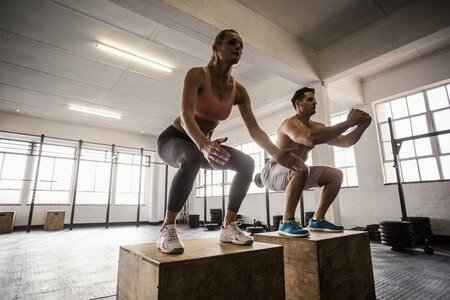 couple do jumping squats together